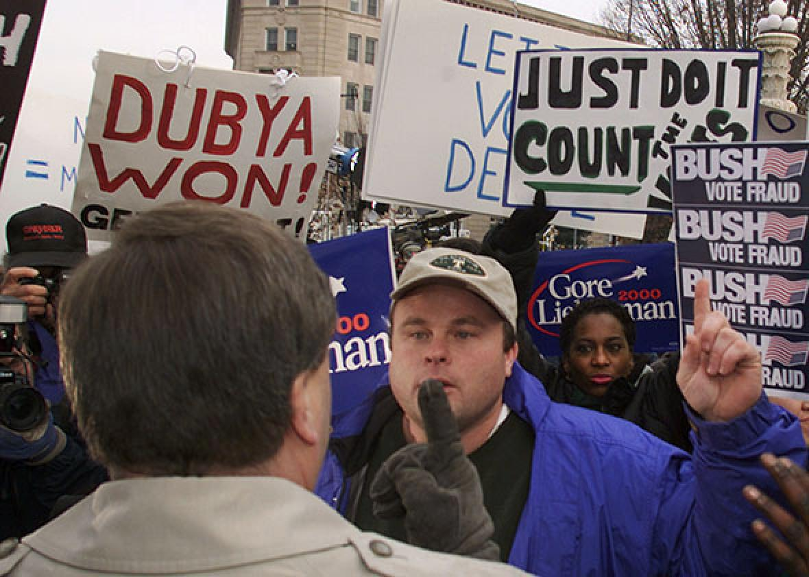 Bush and Gore supporters argue their point to each other in fron