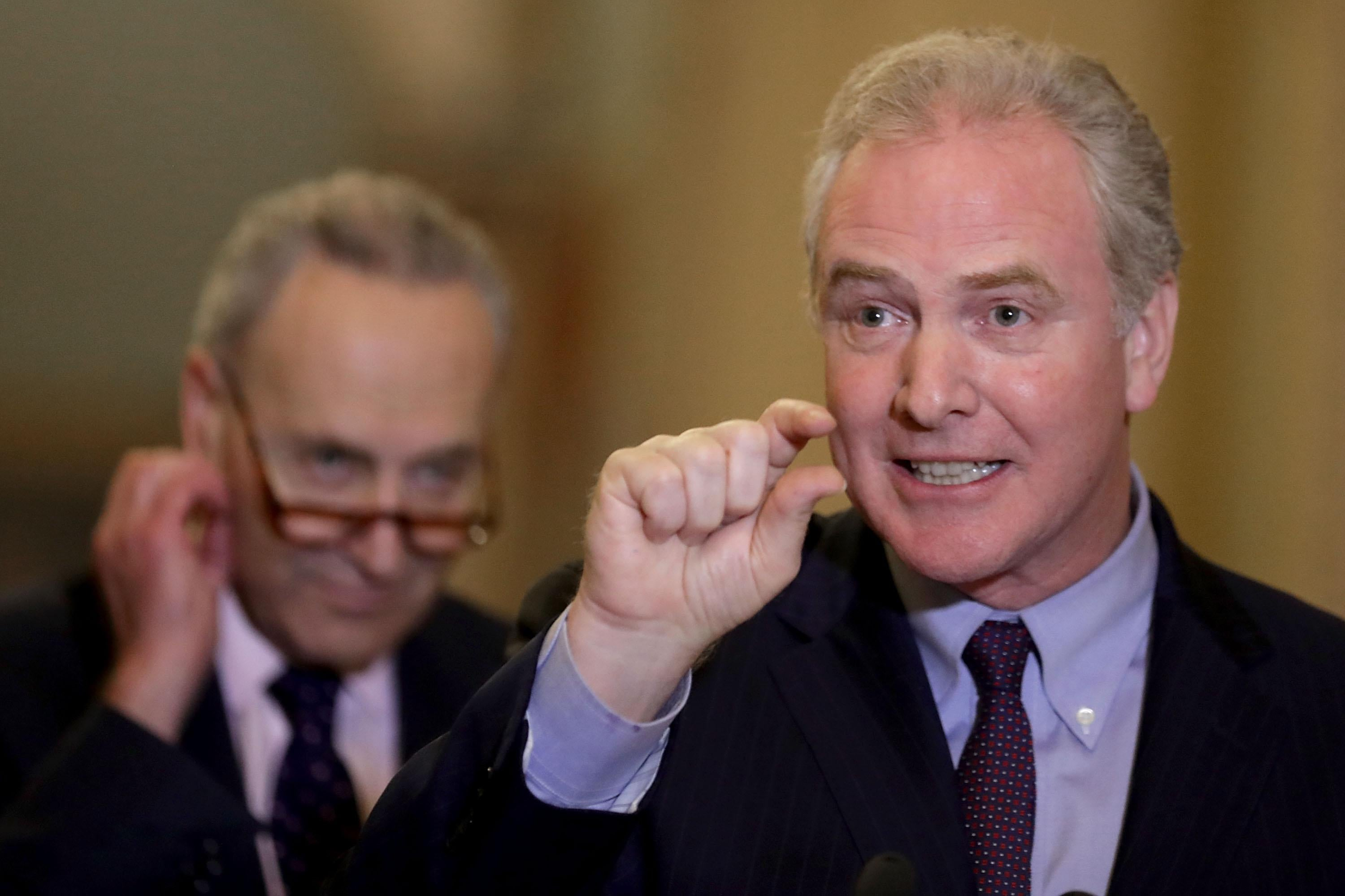 Sen. Chris Van Hollen talks to reporters with Senate Minority Leader Charles Schumer on November 7, 2017 in Washington, DC.