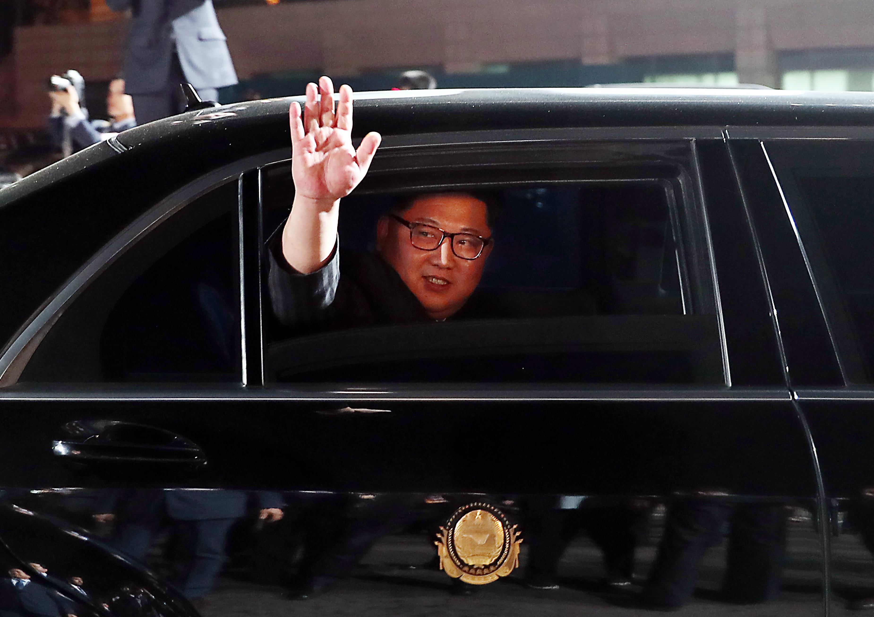 North Korea's leader Kim Jong Un waves in a car as he leaves for the North after a closing ceremony at the end of the historic summit with South Korea's President Moon Jae-in at the truce village of Panmunjom on April 27, 2018.