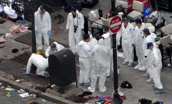 Investigators work the crime scene on Boylston Street following Monday's bomb attack at the Boston Marathon.