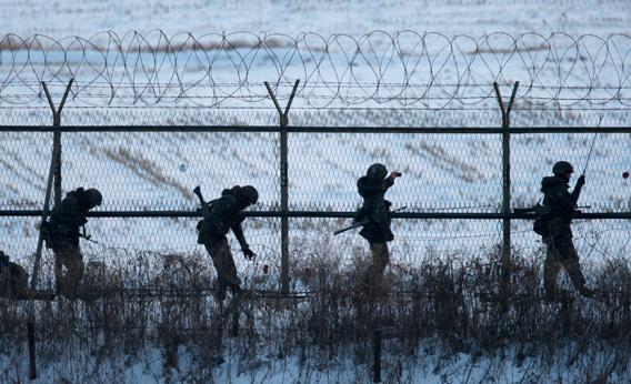 South Korean soldiers check military fences as they patrol near the demilitarized zone separating North Korea from South Korea, in Paju, north of Seoul February 12, 2013.