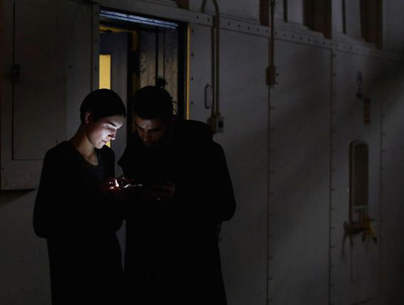 A man and woman looking at a mobile phone in New York, February 11, 2013.