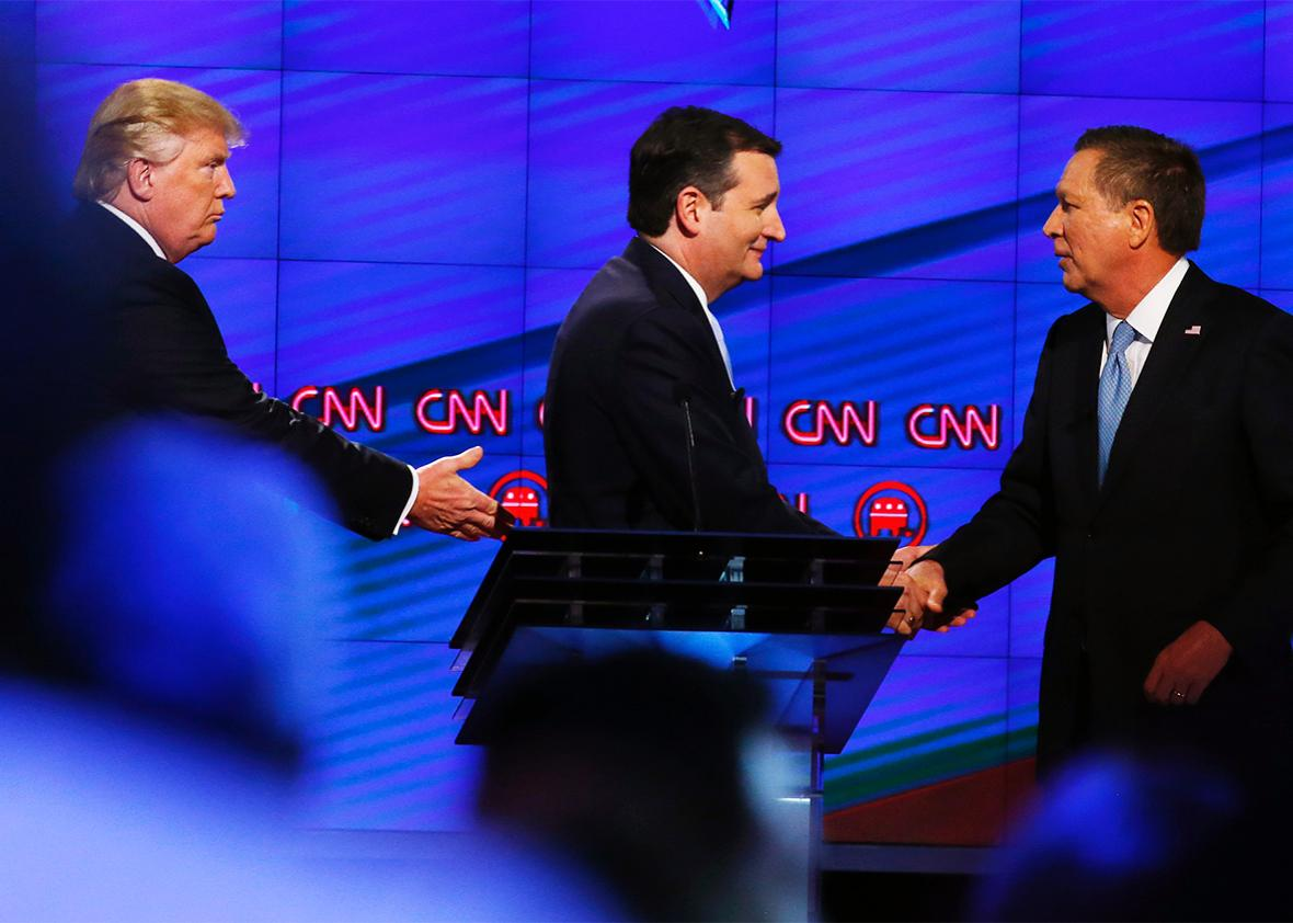 Donald Trump, Texas Senator Ted Cruz and Ohio Governor John Kasich shake hands following the CNN Republican Presidential Debate March 10, 2016 in Miami, Florida.