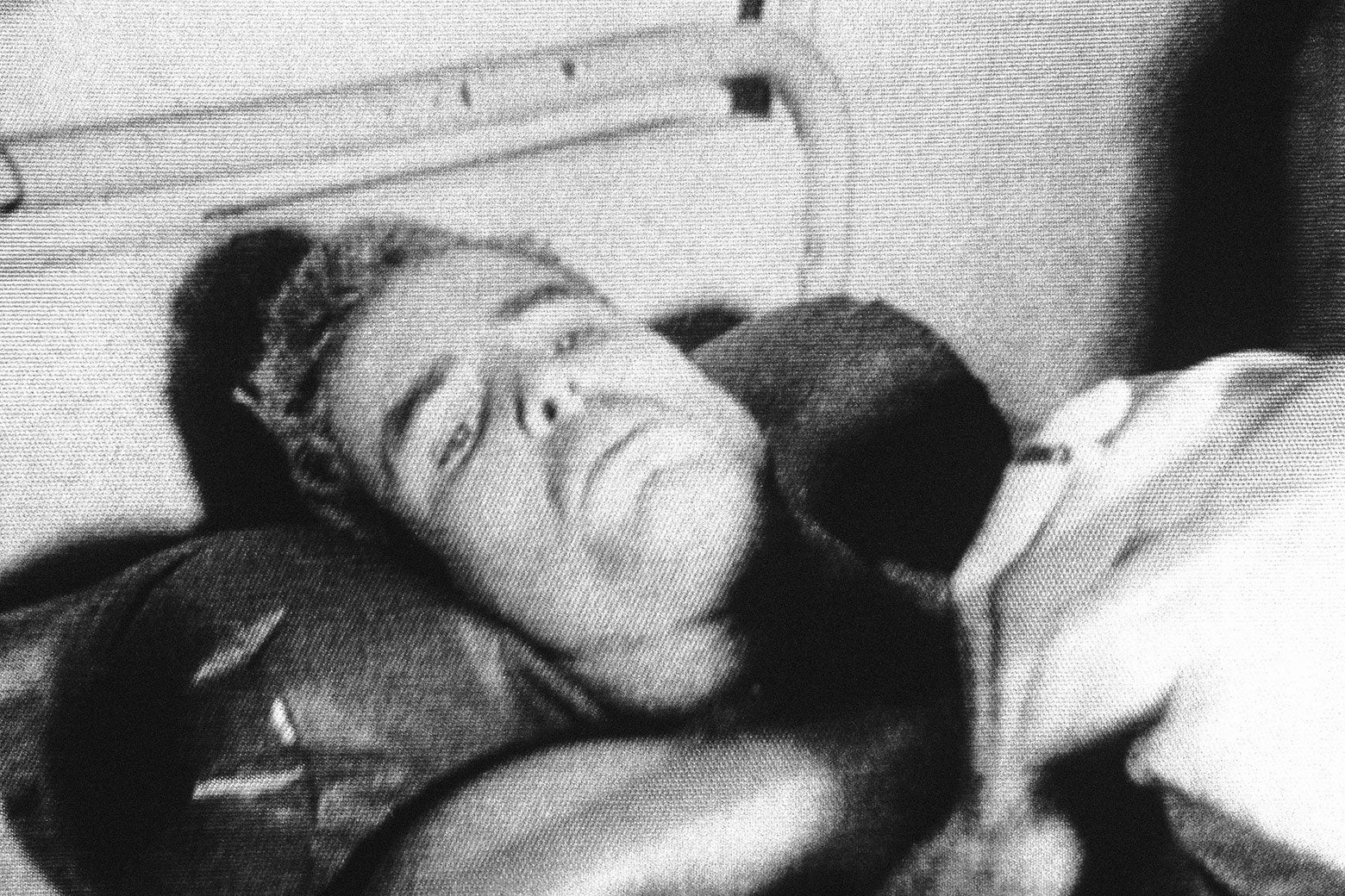 Grainy black and white photo of young McCain on a hospital bed