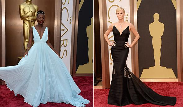 Lupita Nyong'o and Charlize Theron at the 86th Academy Awards on March 2nd, 2014 in Hollywood, California.