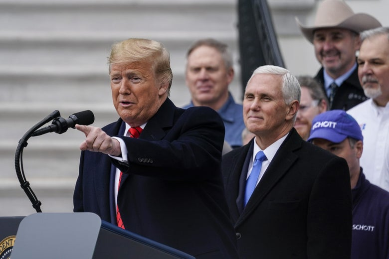 With Vice President Mike Pence looking on, U.S. President Donald Trump speaks before signing the United States-Mexico-Canada Trade Agreement during a ceremony on the South Lawn of the White House on January 29, 2020 in Washington, DC. The new U.S.-Mexico-Canada Agreement (USMCA) will replace the 25-year-old North American Free Trade Agreement (NAFTA) with provisions aimed at strengthening the U.S. auto manufacturing industry, improving labor standards enforcement and increasing market access for American dairy farmers.  The USMCA signing is considered one of President Trump's biggest legislative achievements since Democrats took control of the House in 2018.