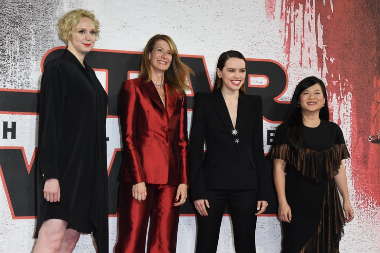Gwendoline Christie, Laura Dern, Daisy Ridley, and Kelly Marie Tran stand for a photo on a red carpet in London.