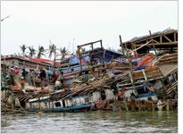 Houses destroyed by cyclone Nargis. Click image to expand.