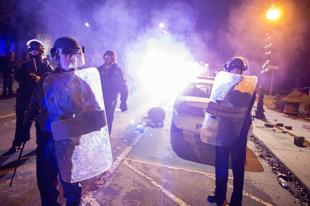 photos of ferguson protests after indictment of officer darren wilson in michael brown case.