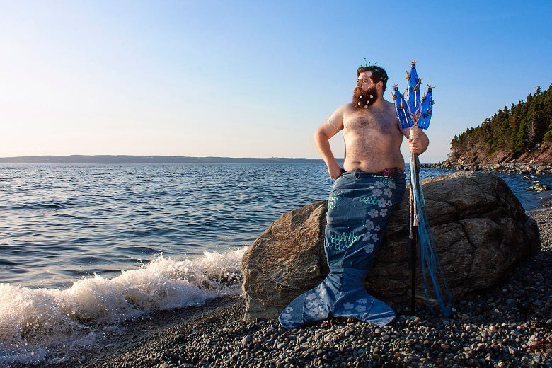 A hairy, colorful merman poses on the Canadian cost.