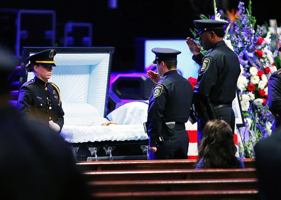 Law enforcement pay respects during a viewing before the funeral service for Senior Corporal Lorne Ahrens held at Prestonwood Baptist Church on July 13, 2016 in Plano, Texas.