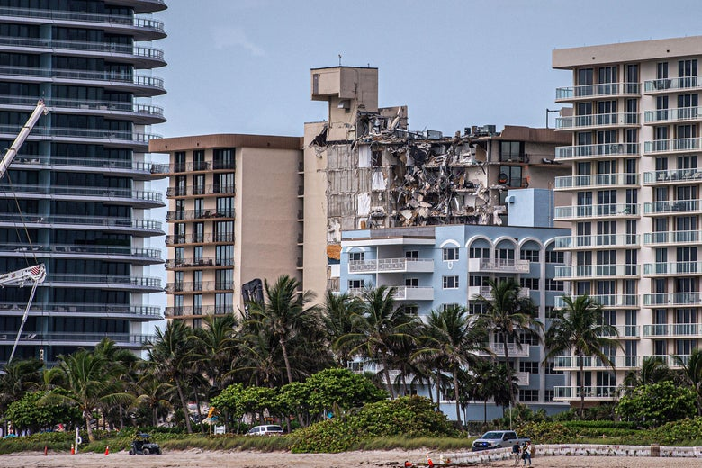 The partially collapsed Champlain Towers South condo amid other oceanfront buildings