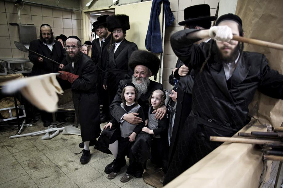 Ultra-Orthodox Jewish men bake the matzo or unleavened bread for the Passover holiday in Jerusalem on March 25, 2013. Religious Jews throughout the world eat matzo during the eight days, which begins on March 25 at sunset and commemorates the Israelites' exodus from slavery in Egypt.