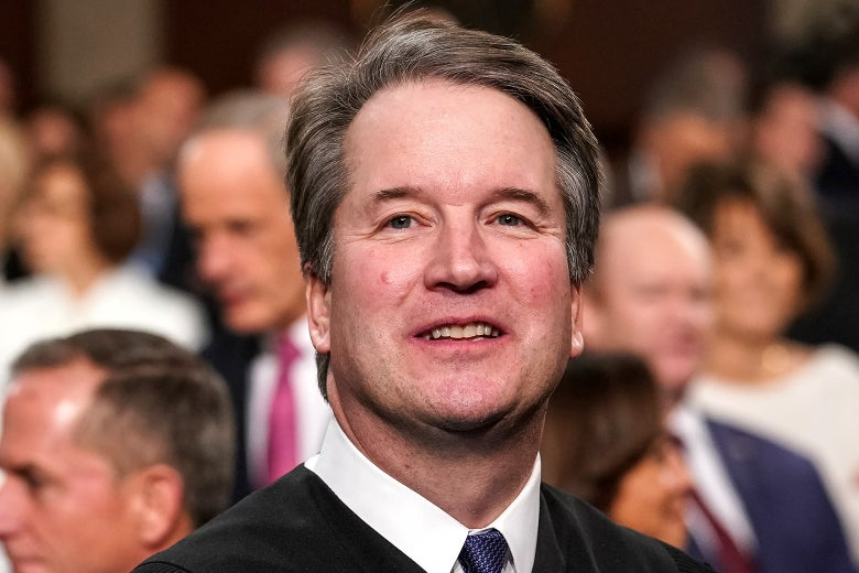 Brett Kavanaugh looking up and smiling.