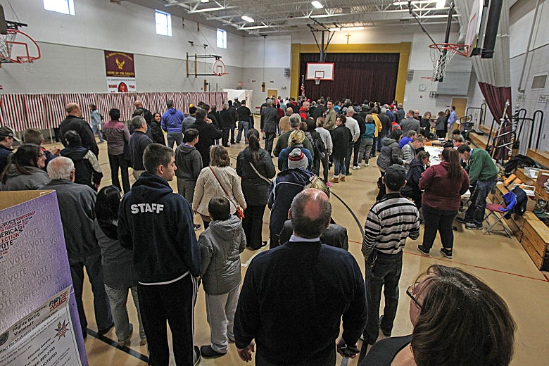 People wait in long lines to vote at Memorial High School in Manchester, New Hampshire, on Nov. 8, 2016.