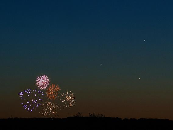 three planets and fireworks