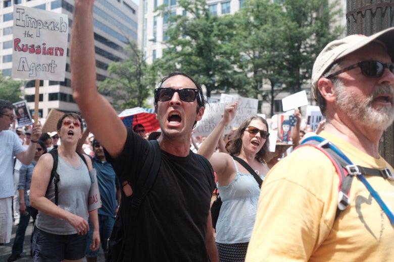 Demonstrators shout at the Trump International Hotel in Washington D.C.