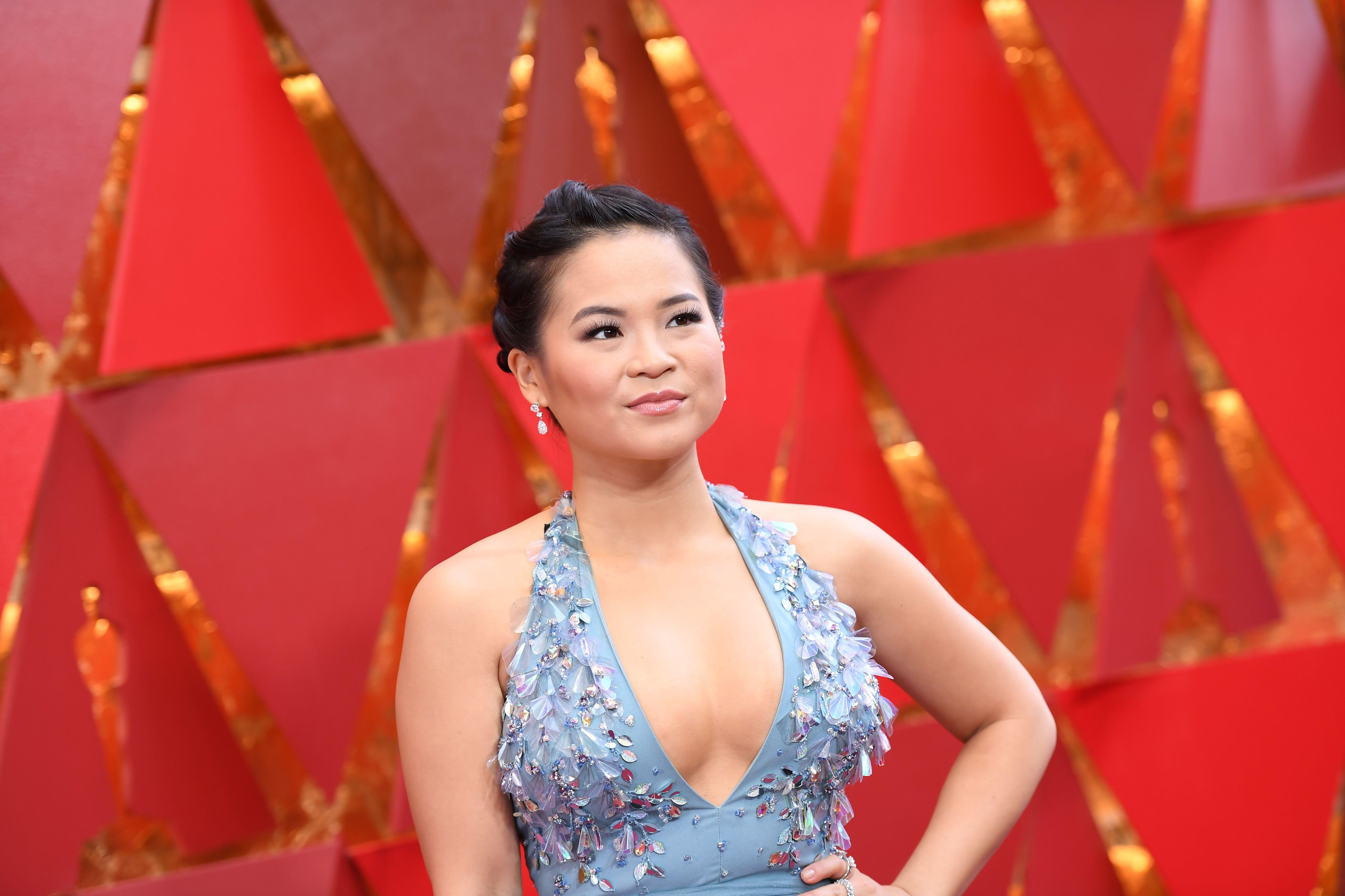 Kelly Marie Tran wears a blue bejeweled dress on the red carpet.