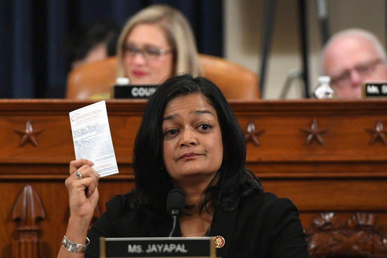 Pramila Jayapal gestures with a copy of the constitution during a hearing.