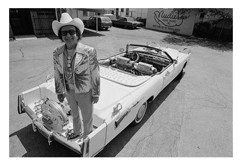 Nudie Cohn costomized each of his many Cadillacs, protecting his work with plastic. This one is decorated with silver-dollar coins and handguns.