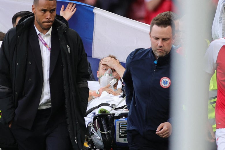 Denmark's midfielder Christian Eriksen (C) is evacuated after collapsing on the pitch during the UEFA EURO 2020 Group B football match between Denmark and Finland at the Parken Stadium in Copenhagen on June 12, 2021.