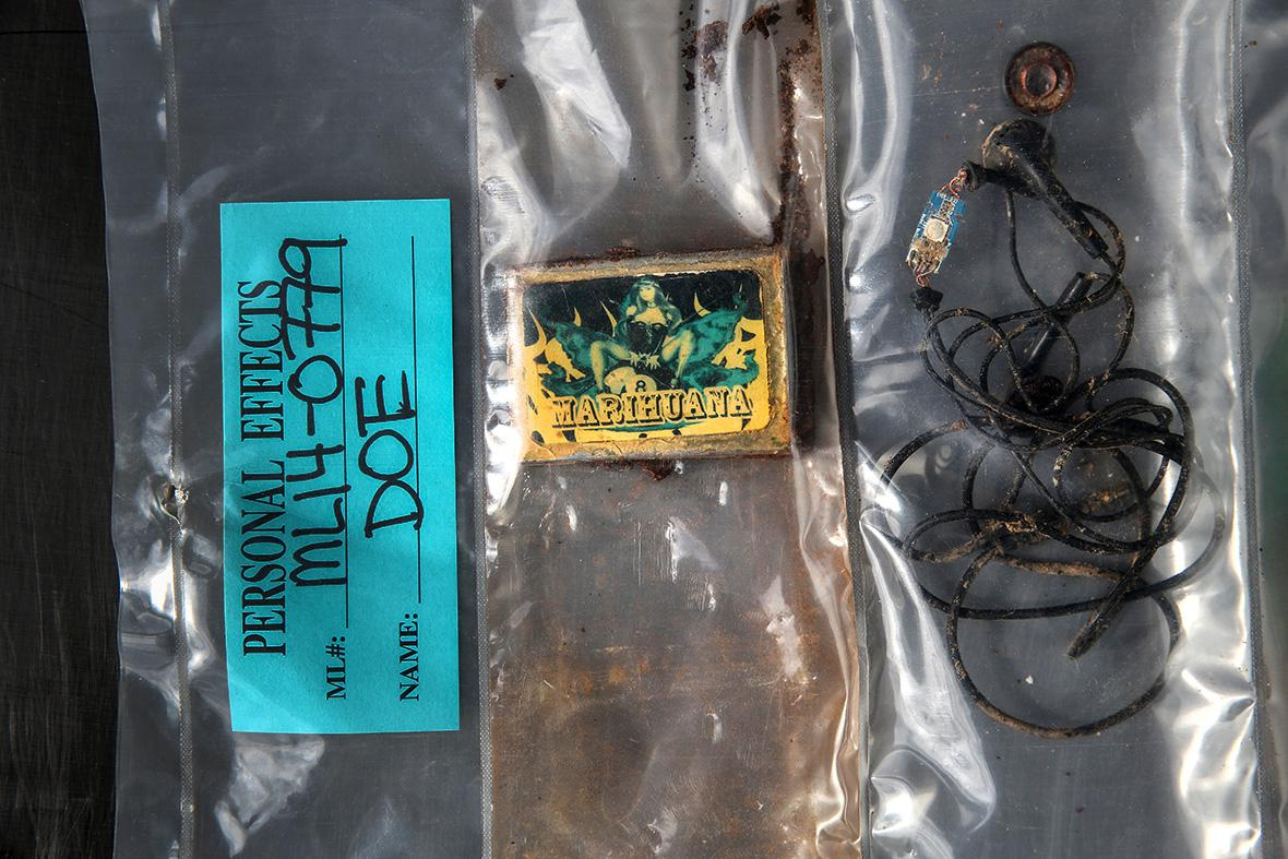 A box of matches and a set of earbuds found with the remains of a person discovered in the Arizona desert.