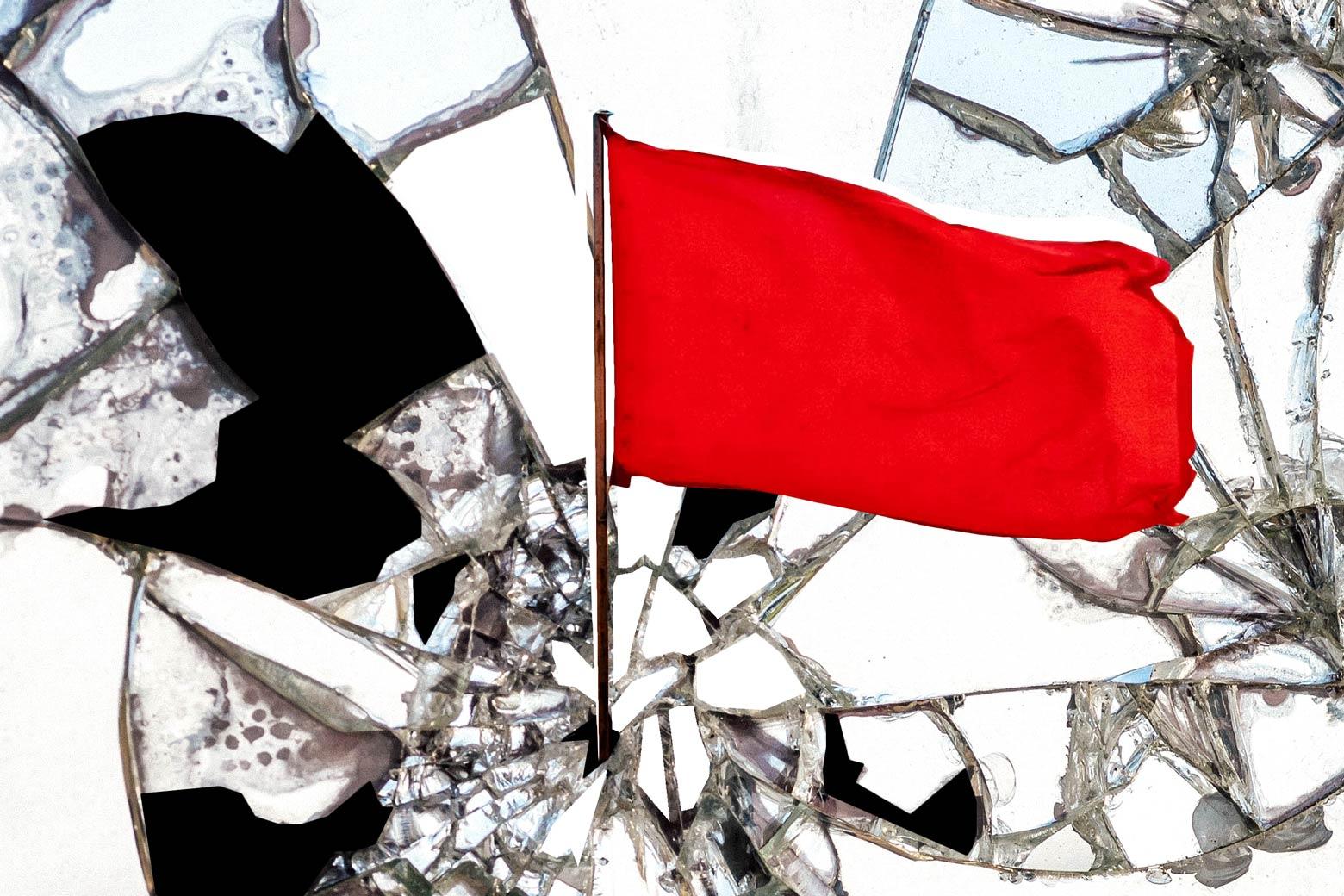 Photo illustration: Red revolutionary flag shattering a mirror.