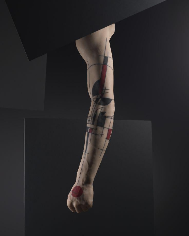Montreal-based tatoo artist Yann Black's design on the silicone model of a man's arm.