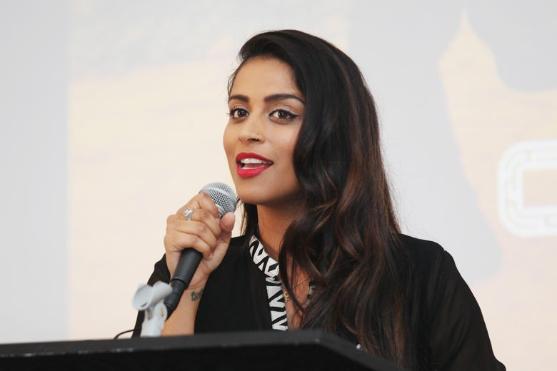 Lilly Singh speaks at a podium.