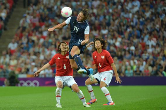 United States's forward Abby Wambach fights for the ball with midfielder Mizuho Sakaguchi and defender Saki Kumagai during the final of the women's football competition of the London 2012 Olympic Games.