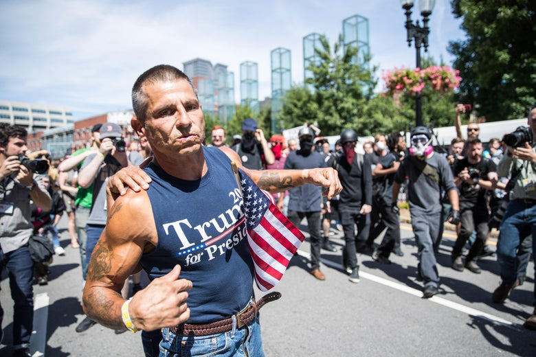 A participant of the Boston Straight Pride Parade is pushed away from counter protesters after an altercation on August 31, 2019 in Boston, Massachusetts.