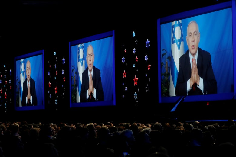 Speaking via satellite feed, Israeli Prime Minister Benjamin Netanyahu addresses AIPAC's conference in Washington on Tuesday.