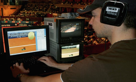 A technician watches screens with the Hawk-Eye system during the Masters Tennis tournament