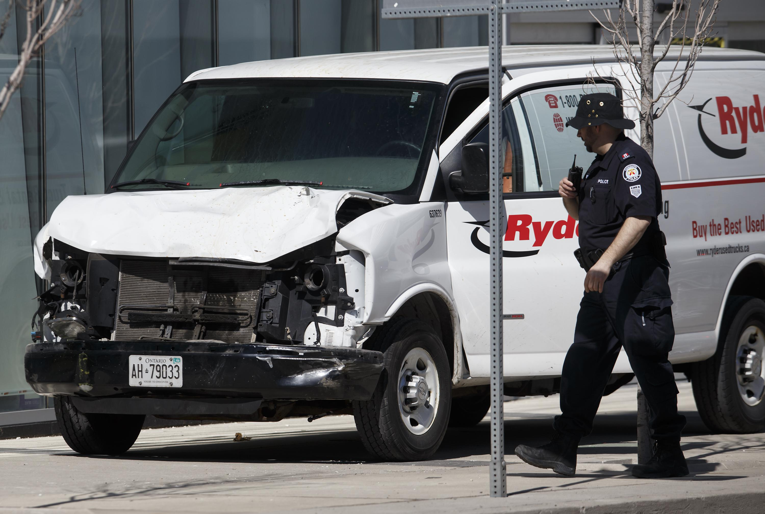 Police inspect a van suspected of being involved in a collision injuring at least eight people at Yonge St. and Finch Ave. on April 23, 2018 in Toronto, Canada.