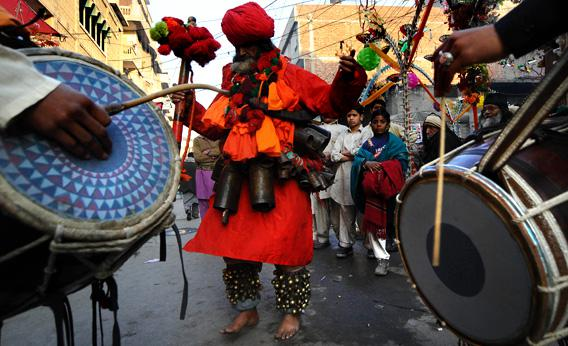 A Pakistani devotee dances outside the shrine of Sufi Saint Data Ganj Bakhsh in Lahore.