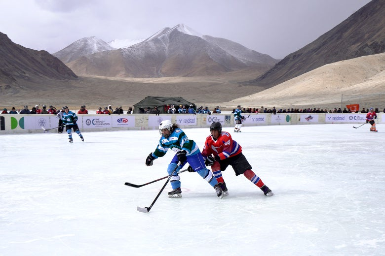The Himalayas loom over the Olympic-size hockey rink in Chibra Kargyam.