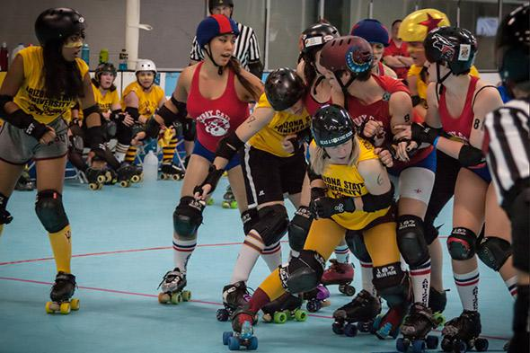 The author (crouching in the foreground) and her Arizona State teammates take on the University of Arizona in a historic college roller derby match.