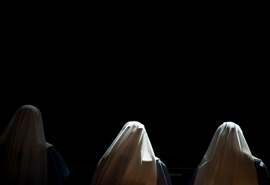 Nuns pray inside St Peter's basilica at the Vatican ahead of the cardinals conclave on March 10, 2013.