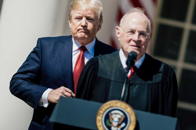 President Donald Trump listens while Supreme Court Justice Anthony Kennedy speaks during a ceremony at the White House on April 10, 2017.