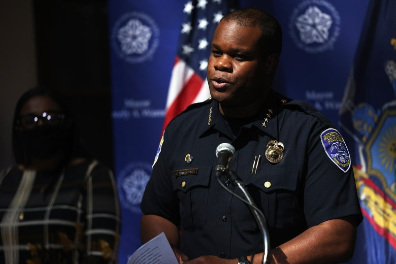 Singletary, in uniform, speaks from a podium.