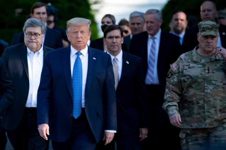 US President Donald Trump walks with US Attorney General William Barr (L), US Secretary of Defense Mark T. Esper (C), Chairman of the Joint Chiefs of Staff Mark A. Milley (R), and others from the White House to visit St. John's Church after the area was cleared of people protesting the death of George Floyd June 1, 2020, in Washington, DC.