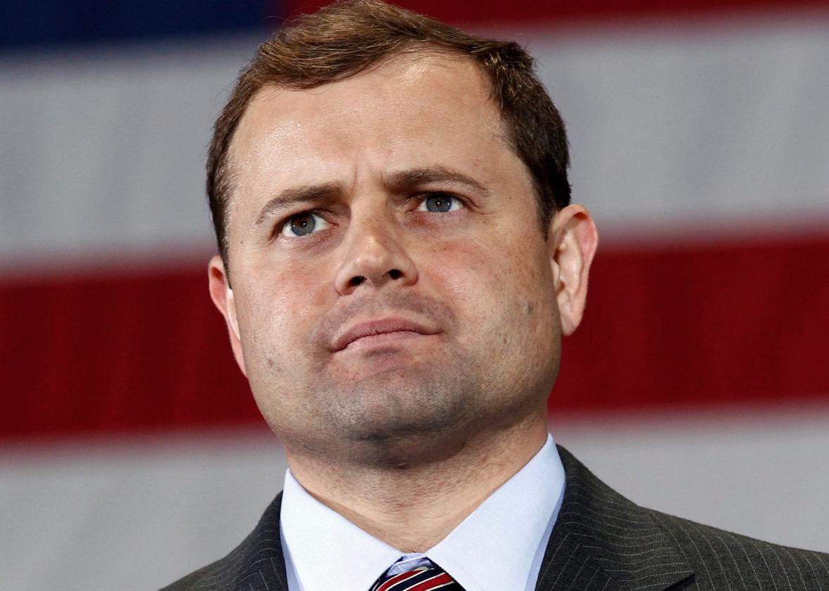 U.S. Representative Tom Perriello (D-VA) listens to U.S. President Barack Obama during a rally in Charlottesville, Virginia October 29, 2010.