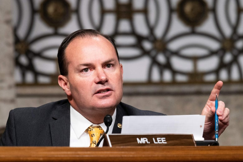 Mike Lee points while seated at a Senate subcommittee hearing