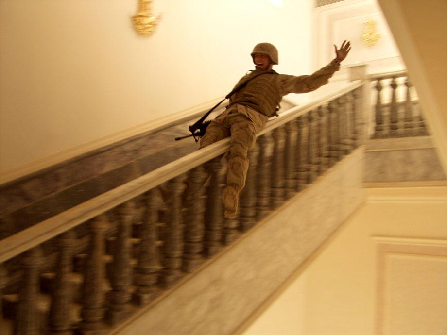 TIKRIT, Iraq—In Saddam's hometown, a U.S. Marine slides down a marble handrail in one of the dictator's extravagant palaces. The residence contained carpets worth hundreds of thousands of dollars and at least one golden toilet. Tikrit was the last major city to fall to Allied forces during the invasion, and, despite fighting that continued through Iraq, Marines celebrated victory, April 14, 2003.