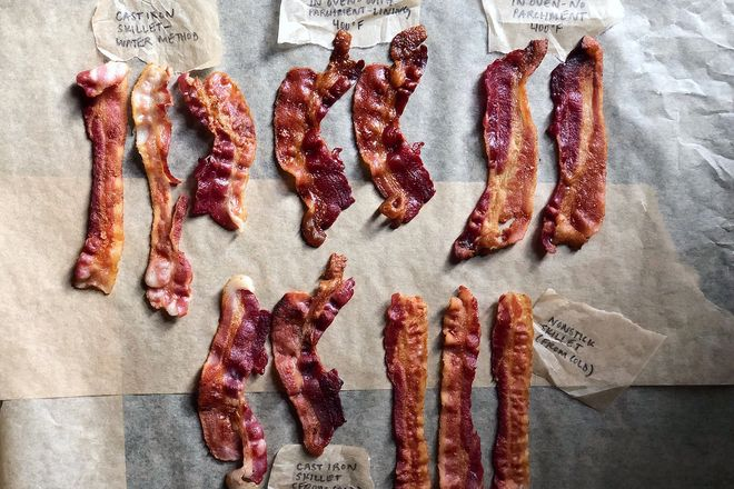 Five groupings of bacon on a table. Some are straight while others are curly.