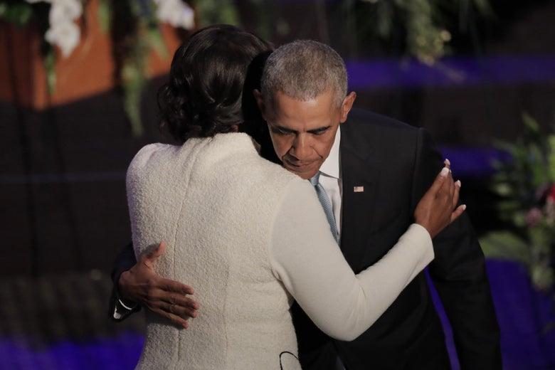 Former President Barack Obama hugs Maya Rockeymoore Cummings while onstage during funeral services for late Rep. Elijah Cummings.