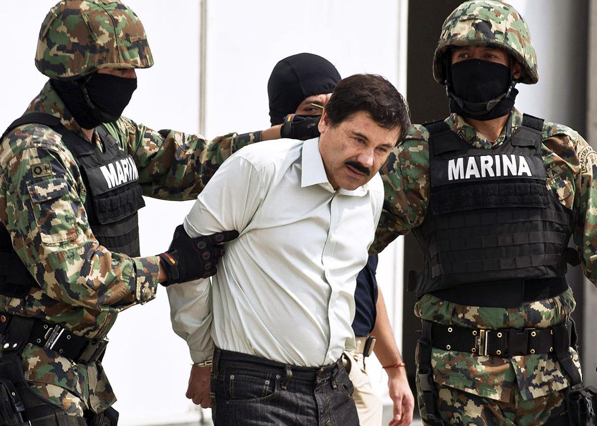"Mexican drug trafficker Joaquin Guzman Loera aka ""el Chapo Guzman"", is escorted by marines as he is presented to the press on February 22, 2014 in Mexico City."