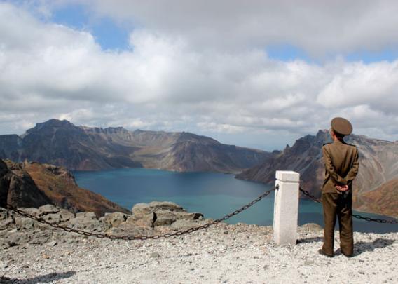 Soldier on Mount Paektu North Korea overlooking Lake Chon.