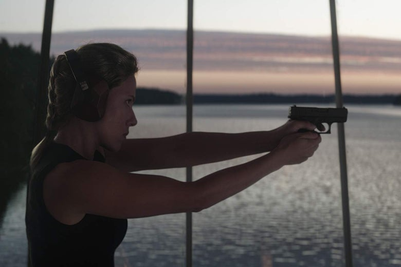 Scarlett Johansson aiming a pistol in a still from Avengers: Endgame.