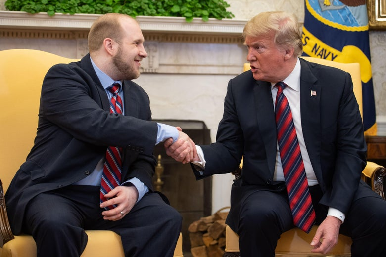 President Donald Trump shakes hands with Joshua Holt, who had been detained in Venezuela for two years, in the Oval Office at the White House in Washington, DC, on May 26, 2018.